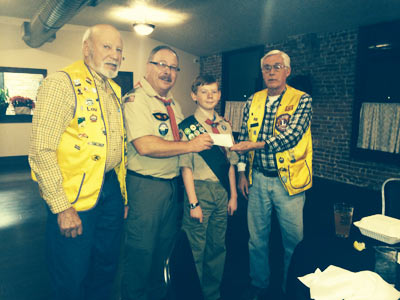 Jacksonville Lions Lou Mayersky and Club President, Bill Hanlan (right) present a check for $150 to Boy Scout Troop 7 Scoutmaster Rick Moir and First-Class Scout Landon Moir.