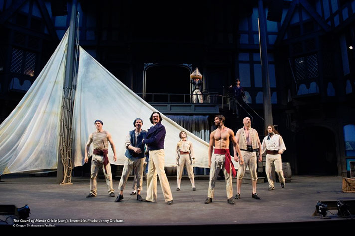 Edmond Dantes (Al Espinosa) and crew of the ship Pharaon (Ensemble) display elation (through dance) upon returning to home port of Marseille during opening of OSF's The Count of Monte Cristo. Photo by Jenny Graham.