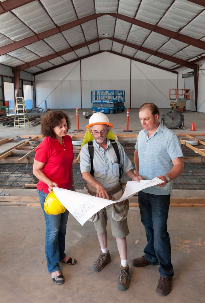 COO Laura Naumes and Winemaker Chris Graves (right) look over plans for Naumes Crush and Fermentation with Kyle White, project manager.