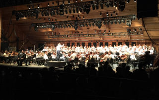 Maestro Teddy Abrams leads the Britt Orchestra, Southern Oregon Repertory Singers, Rogue Valley Chorale, and Baritone soloist Hugh Russell (seated front) in a performance of Carl Orff's Carmina Burana on Opening Night of the Britt Classical Festival, on July 31, 2015 at Jacksonville, OR.